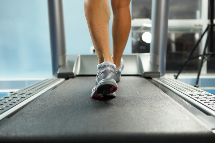 Image of female foot running on treadmill